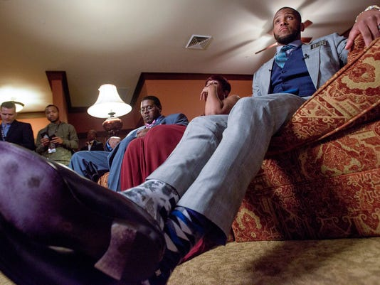 Alabama tight end O.J. Howard watches the NFL football draft at his watch party in Prattville, Ala., Thursday, April 27, 2017.  The Tampa Bay Buccaneers selected Howard with the 19th pick in the first round. (Mickey Welsh/The Montgomery Advertiser via AP)