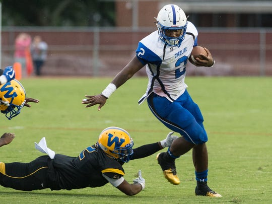 North Caroline's David Bailey (2) dodges a tackle from