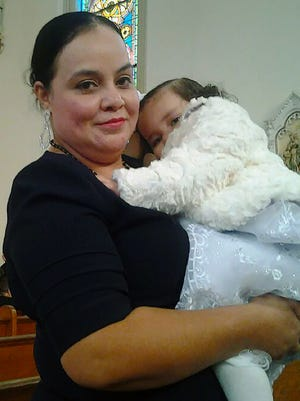 Maribel Trujillo-Diaz, a mother of four children who lived in the Cincinnati suburb of Fairfield, Ohio, was deported April 19, 2017, to Mexico. She is holding her youngest child at St. Charles Borromeo Catholic Church in Cincinnati.
