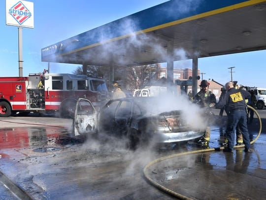 Wichita Falls firefighters work to knock down a vehicle fire Wednesday morning at the Valero convenience store located on Broad St. Firefighters responded to a report that a vehicle was on fire endangering the fuel pumps. Fire investigators are on the scene investigating the cause of the fire. No injuries were reported.