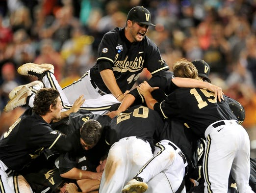 Vanderbilt players celebrate a 3-2 win over Virginia at the College World Series at TD Ameritrade Park in Omaha, Neb., Wednesday, June 25, 2014.