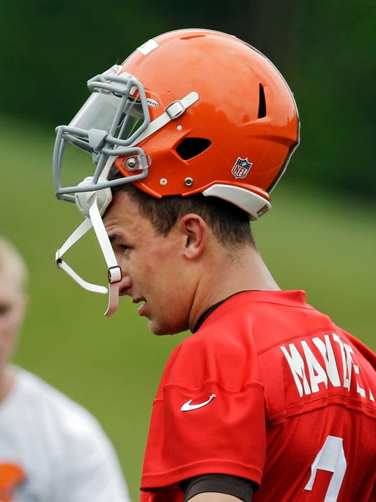 Cleveland Browns quarterback Johnny Manziel (2) takes a break during a mandatory minicamp practice at the NFL football team's facility in Berea, Ohio Tuesday, June 10, 2014. (AP Photo/Mark Duncan)