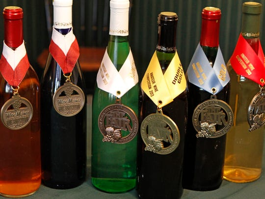 Some of the medal-winning wines created by Joe DiPonzio, all made in 2013, are on display in his Chili home.