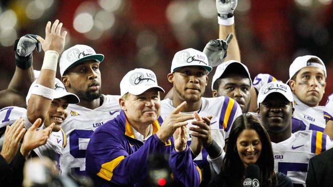 Dec 3, 2011; Atlanta, GA, USA; LSU Tigers head coach Les Miles and players celebrate following a win over the Georgia Bulldogs in the 2011 SEC championship game at the Georgia Dome.  Mandatory Credit: Derick E. Hingle-USA TODAY Sports