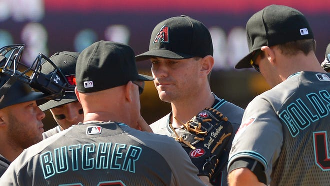 Apr 12, 2016; Los Angeles, CA, USA; Arizona Diamondbacks pitching coach Mike Butcher (23) talks with relief pitcher Daniel Hudson (41) on the mound in the eighth inning of the game against the Los Angeles Dodgers  at Dodger Stadium. Diamondbacks won 4-2.