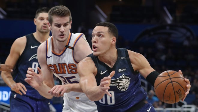 Mar 24, 2018: Orlando Magic forward Aaron Gordon (00) drives to the basket as Phoenix Suns forward Dragan Bender (35) defends during the first quarter at Amway Center.