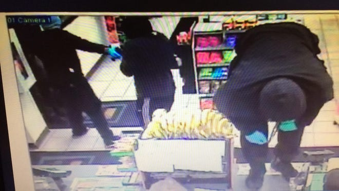 Store surveillance photos have been released of suspects wanted for two armed robberies in Wayne.