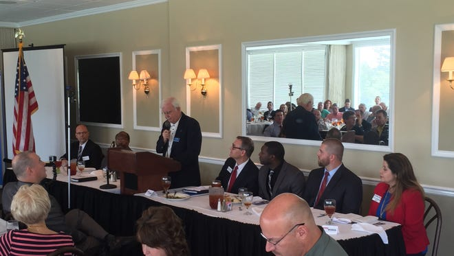 City Commission candidates debate the issues Tuesday during a forum hosted by the Network of Entrepreneurs and Business Advocates. From left are Steven Hougland and City Commissioner Curtis Richardson, candidates for Seat 2, NEBA program director Ted Thomas, and Rick Minor, Bruce Strouble, Luther Lee and Gloria Pugh, candidates for Seat 1.