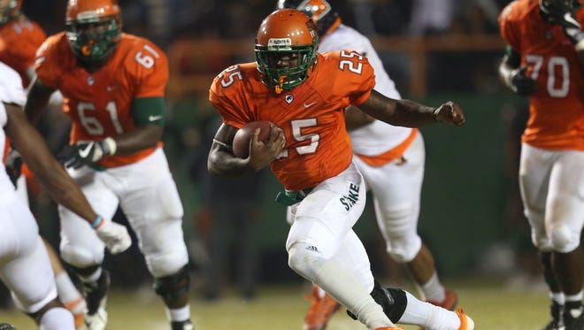 FAMU's Devin Bowers runs the ball against Morgan State during their game at Bragg Memorial Stadium on Saturday, Nov. 12, 2016.