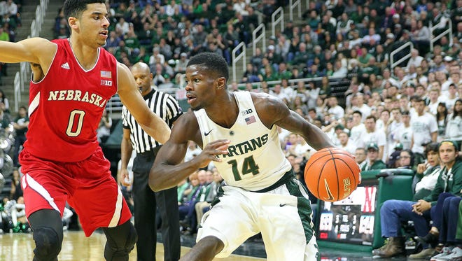 Tai Webster, left, helped Nebraska beat Michigan State last season at Breslin. Webster, a senior point guard, leads the Huskers' at 18.3 points per game.