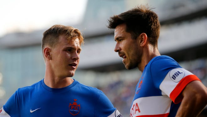 FC Cincinnati's Jimmy McLaughlin (20) and Andrew Wiedeman (23) set up a play in the second half of the USL soccer match between FC Cincinnati and Toronto FC II at Nippert Stadium on Saturday, May 27.