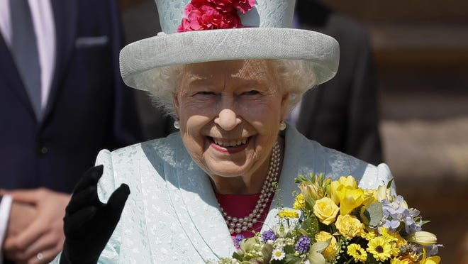 Britain's Queen Elizabeth II waves to the public as she leaves after attending the Easter Mattins Service at St. George's Chapel, at Windsor Castle in England Sunday, April 21, 2019.