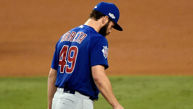 Cubs starting pitcher Jake Arrieta reacts after giving up a home run during the sixth inning against the Dodgers.