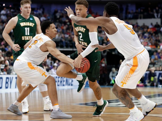 Tennessee forwards Grant Williams (2) and Admiral Schofield (5) combine to strip the ball away from Wright State forward Everett Winchester (2) in the second half of a first-round game at the NCAA college basketball tournament in Dallas, Thursday, March 15, 2018. (AP Photo/Tony Gutierrez)