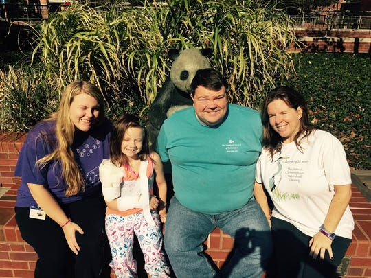 Emily Ruckle is surrounded by her sister, Megan (left) and parents, Todd and Maria Ruckle.