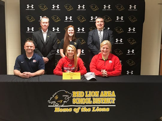 Front row, from left to right: Walt Engles, Tessa Engles and Amy Engles. Back row: athletic director Arnie Fritzius, coach Megan Mahon and Red Lion High School principal Mark Shue.