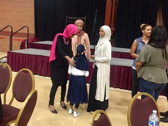Women and girls lined up to meet Minnesota Rep. Ilhan