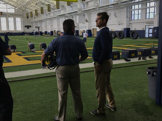 """I'm still pinching myself that I'm here,"" former fire chief Dave Piche (left) said about the chance to work under U-M football coach Jim Harbaugh."
