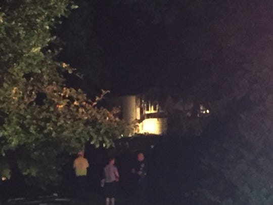 The fire is out, but damage to the house on Manor Road, York Township, was visible.
