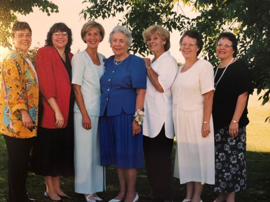Sandra Gresham, third from left, with her mother, center,