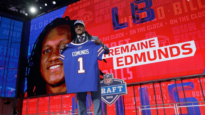 Virginia Tech's Tremaine Edmunds poses with his Buffalo Bills jersey during the first round of the NFL football draft, Thursday, April 26, 2018, in Arlington, Texas. (AP Photo/David J. Phillip)