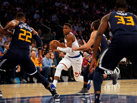 New York Knicks guard Frank Ntilikina (11) drives to