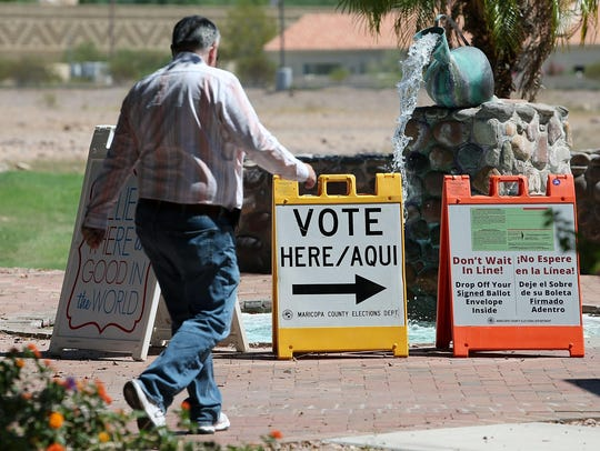Arizona voters make their way to a polling place to
