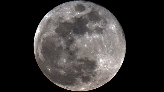 The full moon is seen during a penumbral lunar eclipse in Mexico City on June 5, 2020.