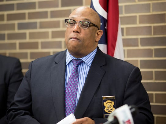 Cincinnati Police Chief Eliot Isaac discusses heroin overdoses numbers during a press conference at the Hamilton County coroner's office.