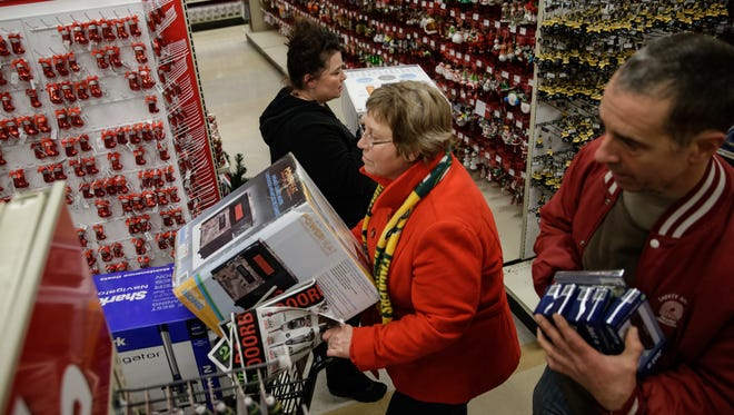 Shoppers navigate the aisles at Shopko once the doors opened.