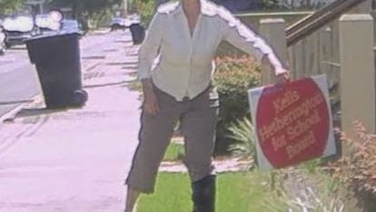 A Pensacola resident recorded a woman stealing a school board campaign sign from his front yard.