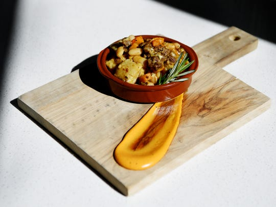 Capella on 9's ñoquis de papa comes with potato gnocchi merguez, butternut squash and braised beans.