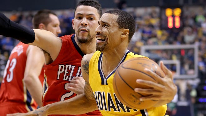 The Indiana Pacers play the New Orleans Pelicans Tuesday, December 23, 2014, evening at Bankers Life Fieldhouse. Indiana Pacers guard George Hill (3) drives around New Orleans Pelicans guard Austin Rivers (25) in the first half of their game.