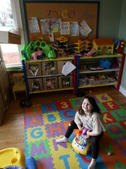 Guinevere Cooper, 6, plays at the Salem Interfaith Hospitality Network's day center in West Salem on Thursday, April 2.
