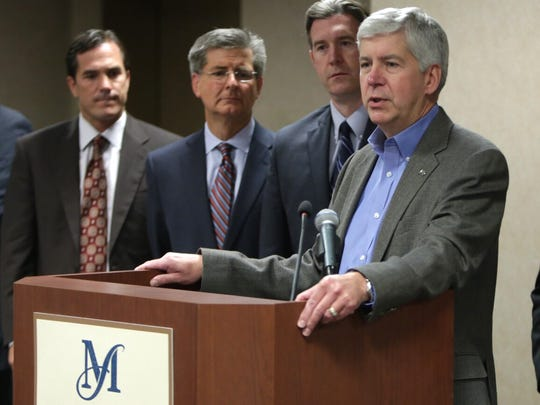 Governor Rick Snyder makes an announcement to switch the Flint water system back to Detroit during a press conference on Thursday October 8, 2015 at the Mott Foundation / Commerce Center Building in downtown Flint.