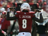Louisville's Lamar Jackson (8) tries to fire up the crowd after scoring against Boston College on Saturday at Papa John's Cardinal Stadium. Oct. 14, 2017