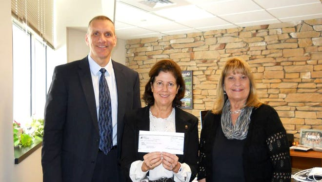 Lebanon School District Superintendent Marianne Bartley (center) receives a check for the Cedar Foundation in the amount of $7500 on behalf of First Citizens Community Bank from Southcentral Region President James Rovito, and Cynthia Zumbrennen, Southcentral Region vice president-business banking.