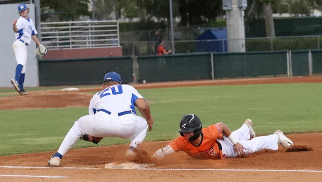 DeLand Suns shortstop Greg Lewandoski, right, dives back toward first base during the first inning of the team's home opener Tuesday night.