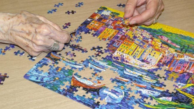 """Boats & Old Town"" was the 16th puzzle Edna Hultberg of Monroe, Michigan, and her daughter, Karyn Brody, completed during the COVID-19 pandemic. Puzzles have become a stress relief for many families since the pandemic began."