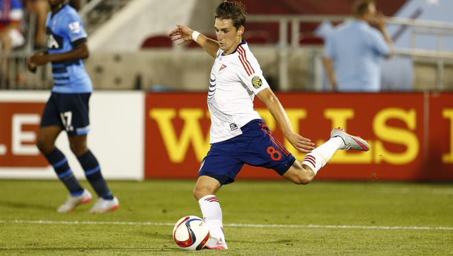 MLS All Stars midfielder Ethan Finlay (8) of Columbus Crew SC kicks the ball during the second half of the 2015 MLS All Star Game at Dick's Sporting Goods Park. Finley is a Marshfield graduate. MLS All Stars defeated Tottenham Hotspur 2-1.