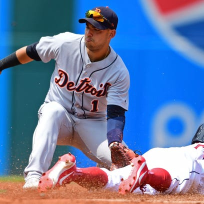 Tigers shortstop Jose Iglesias, left, waits for the