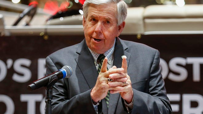 Gov. Mike Parson speaks at Bass Pro Shops on the first day the outdoor store reopened after shutting down to help slow the spread of the coronavirus.