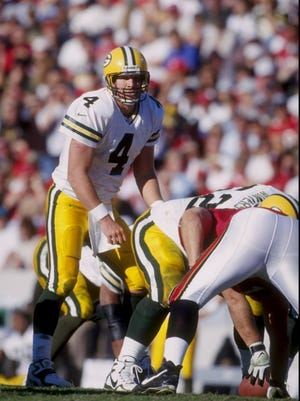 "Packers quarterback Brett Favre had to quiet a ""Go Pack Go"" chant at one point during a Dec. 1997 victory in Tampa Bay."