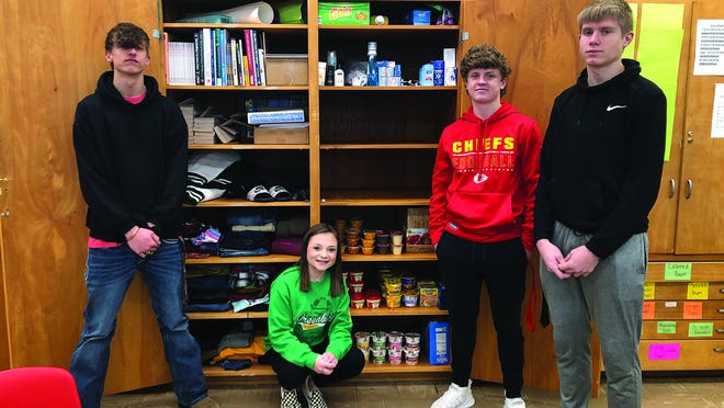 Pratt High JAG-K students stock the Speak Life Community Closet for other students in need. Helping earlier this week were (from left) Jayven Teets, Olivia Muntz, Tyler Reimer and Brock Hudson.