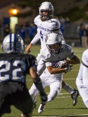 Spanish Springs running back Gabby Ordaz runs for a touchdown in the first half against McQueen in their football game played at McQueen High School on Friday, September 30, 2016.