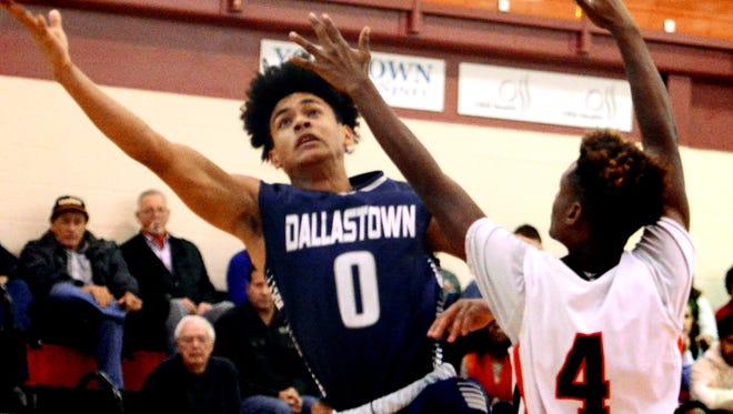 Dallastown's Braden Caldwell takes a shot with Central York's Saa'hir Cornelius defending during basketball action at Central Tuesday, Dec. 12, 2017. With the early-season injuries to Da'Trail Albert and Brandon McGlynn, Caldwell and the rest of the Wildcats are having to take on larger roles to make up for their absence. Bill Kalina photo
