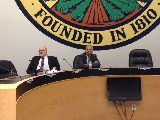 California Public Utilities Commission President Michael Picker (right) and commission member Mike Florio watch a presentation during a public forum at San Bernardino City Hall on May 31, 2016.