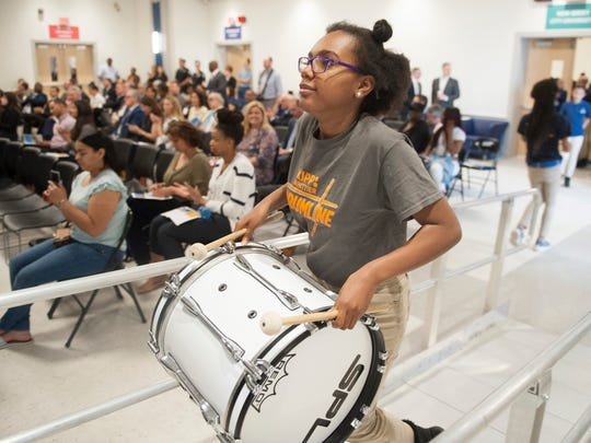 Gabrielle Rigney, a member of the KIPP Cooper Norcross Academy John Greenleaf Whittier Middle School's drumline, prepares to perform during the school's dedication ceremony in Camden on Monday, May 7, 2018.