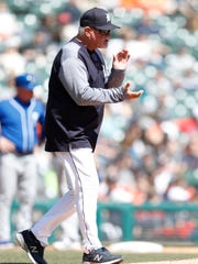 Tigers manager Ron Gardenhire claps as he walks to the mound during the sixth inning of the Tigers' 8-5 loss to the Royals on Sunday, April 22, 2018, at Comerica Park.