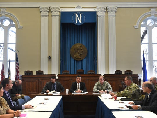 Governor Brian Sandoval, middle, speaks during a briefing on possible spring flooding at the Old Assembly Chambers in the Nevada State Capital Building in Carson City on April 13, 2017. Nevada Department of Public Safety Chief Caleb Cage is seen on the Governor's left and Brigadier General William Burks of the Nevada National Guard is seen on the right.